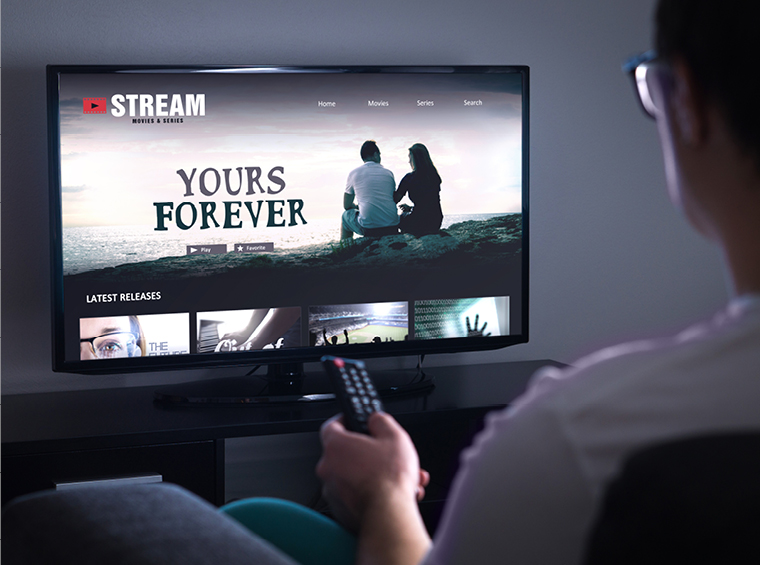 Man watching TV Streaming Television