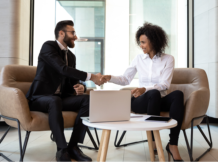 Man and woman shaking hands Refer a Business