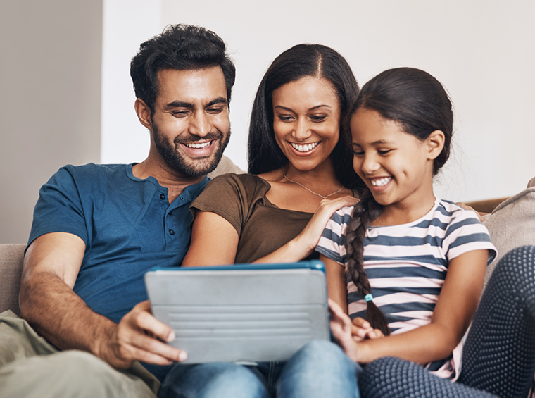 Happy family using a tablet