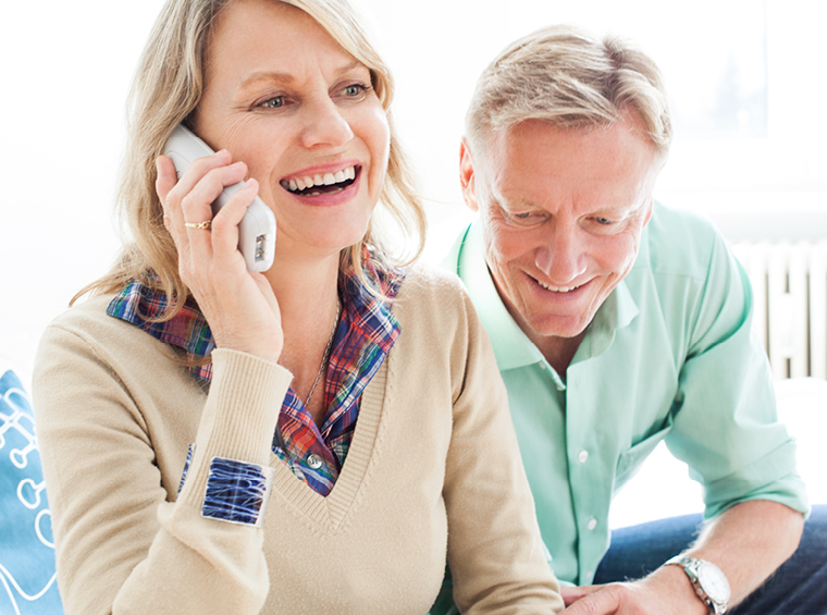 Mature couple laughing on phone