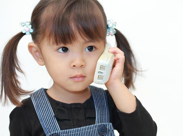 Little girl on landline phone