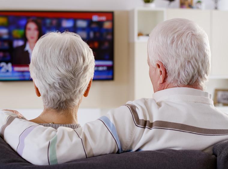 Elderly couple watching the news